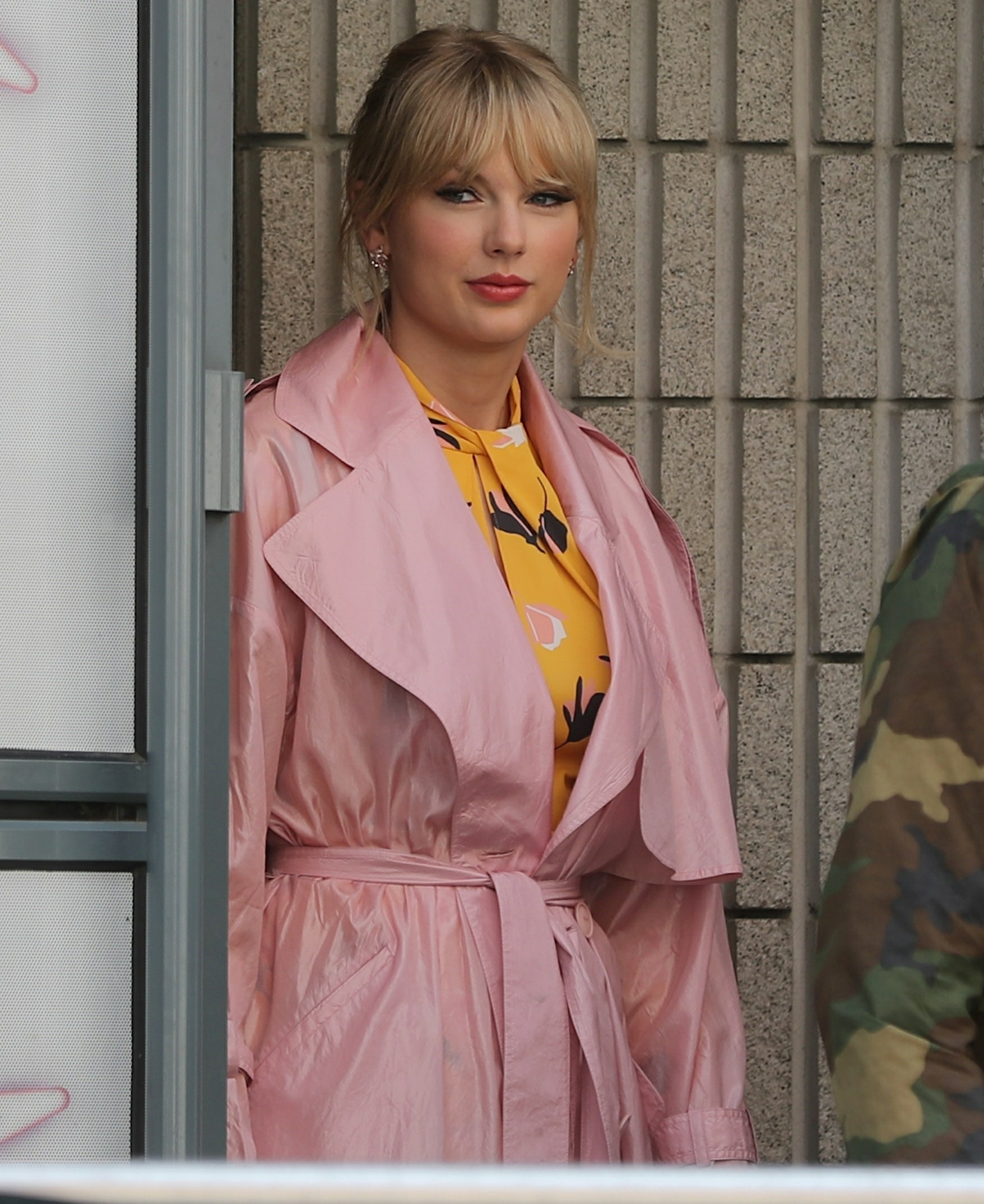 Taylor Swift greets a large crowd of fans as she leaves Radio NRJ