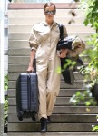 Irina Shayk leaves Bradley Cooper's home with a suitcase