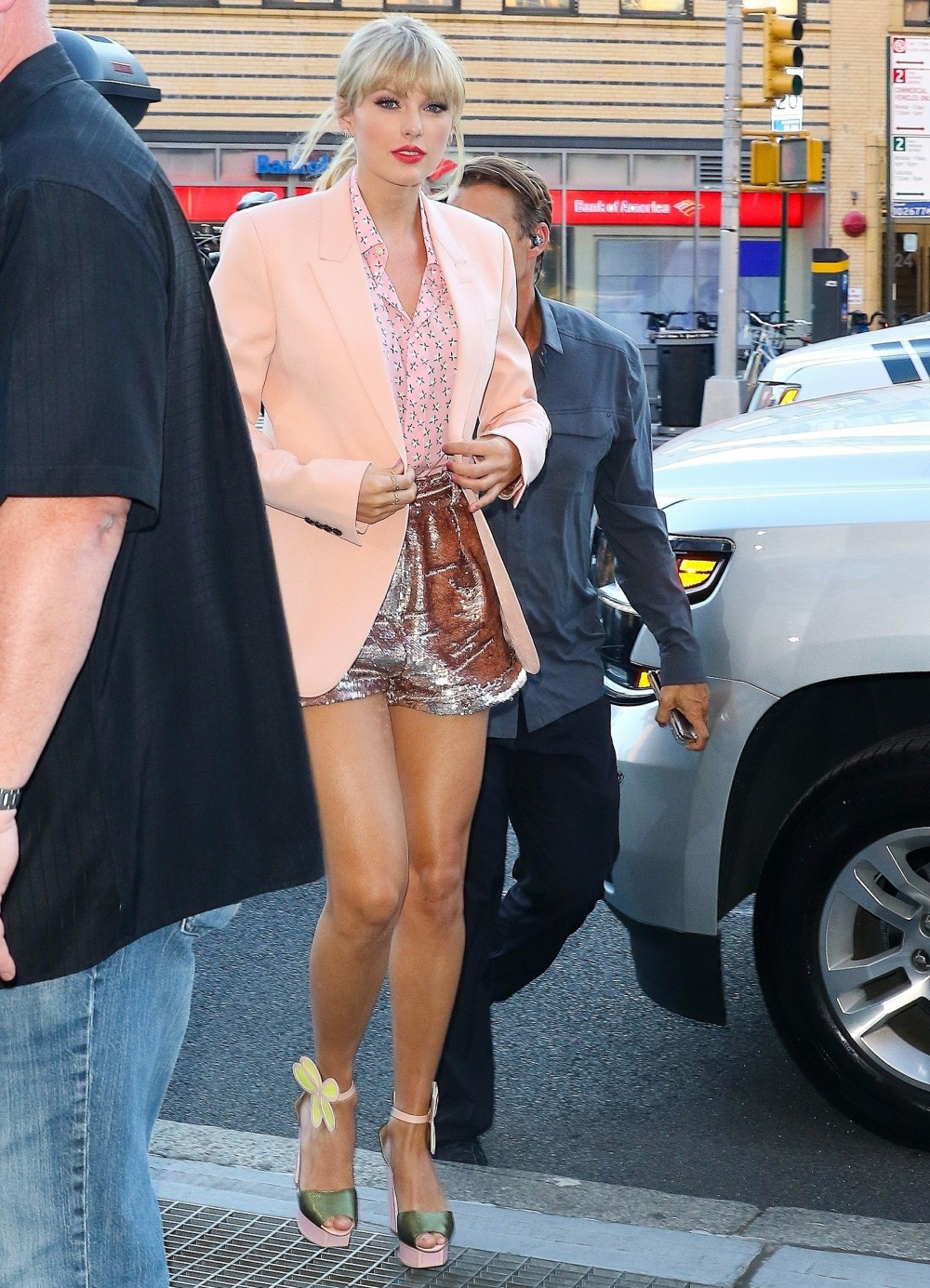 Taylor Swift shows off her legs as she leaves her apartment in New York