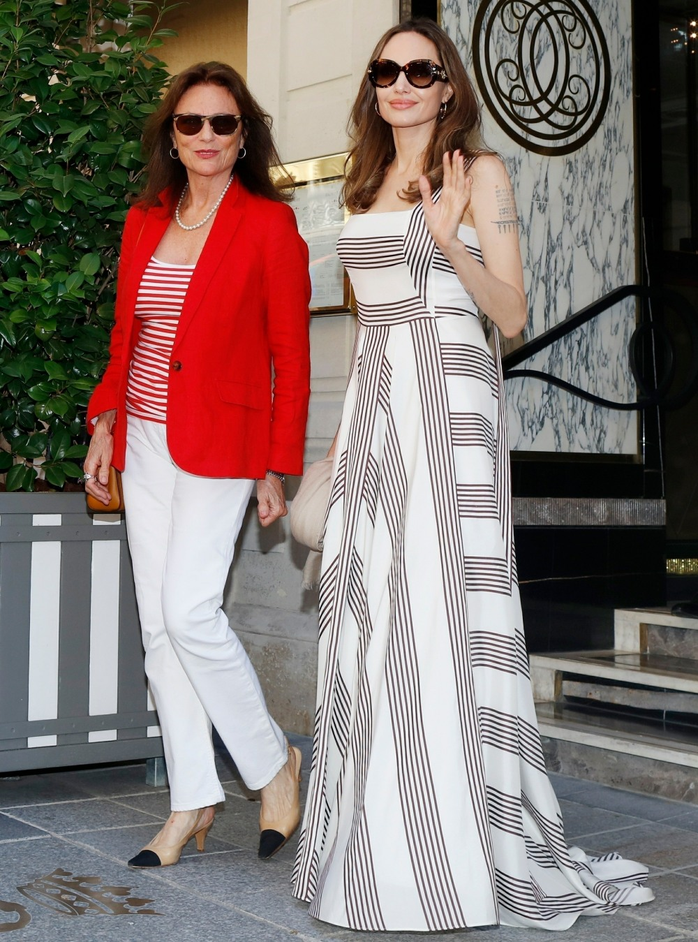 Angelina Jolie and Jacqueline Bisset leave their hotel in Paris