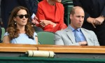 Prince William and Kate Middleton in the stands of the Wimbledon tournament in London