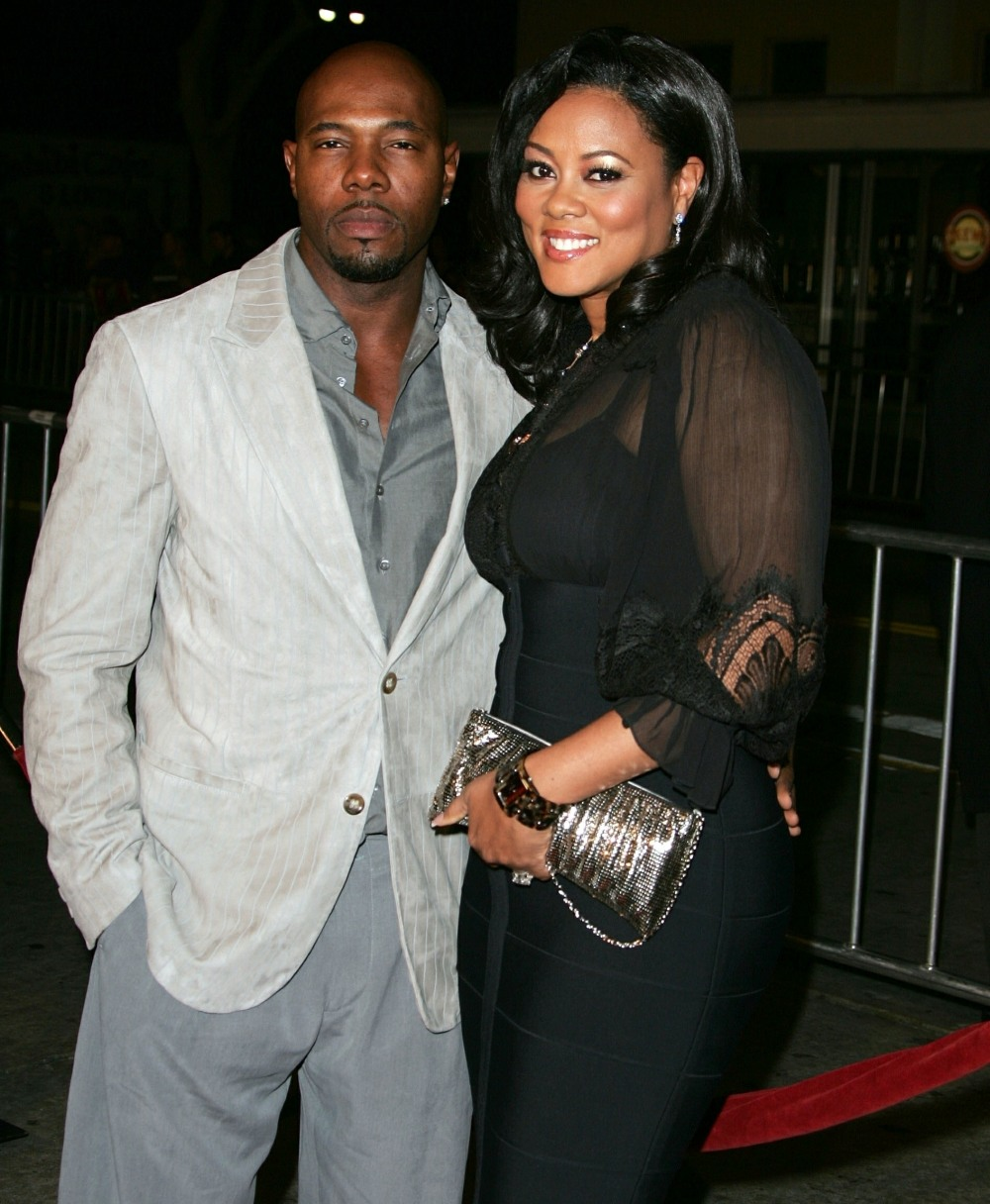 Director Antoine Fuqua has been spotted kissing Nicole Murphy poolside!  **FILE PHOTOS**