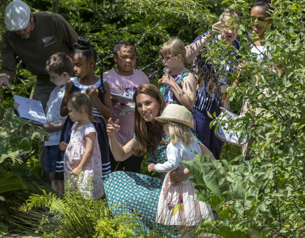 The Duchess of Cambridge with children from Evelina Children'Äôs hospital and the Anna Freud Centre .The Duchess of Cambridge visits her Back to Nature Garden at Hampton Court Palace Garden Festival that she co designed with Andrv©e Davies and Adam White .Hampton 1 July 2019