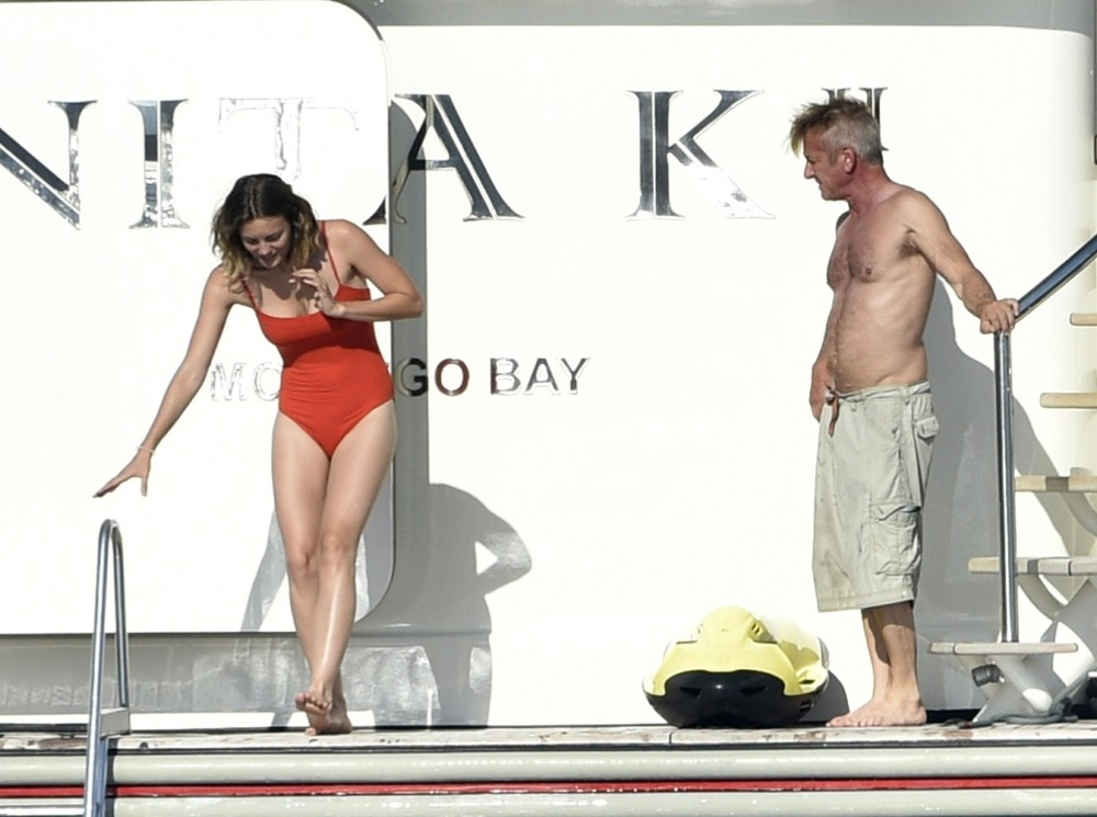 Sean Penn and his girlfriend Leila George are seen in Sardinia