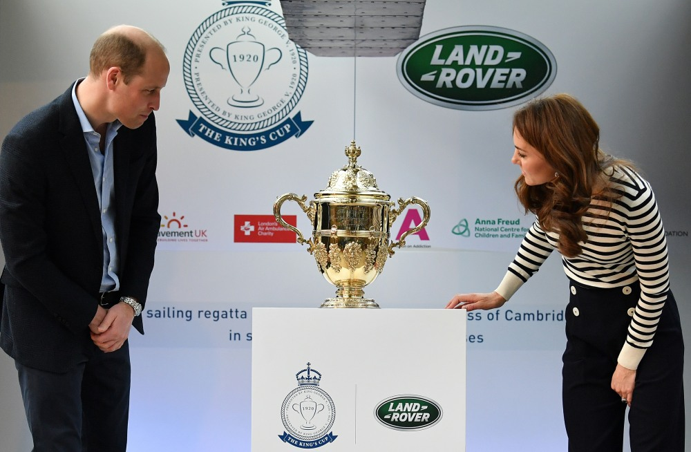 Britain's Catherine, Duchess of Cambridge (R) and Britain's Prince William, Duke of Cambridge unveil the King's Cup trophy during the launch the King's Cup Regatta, at the Cutty Sark in Greenwich, south east London on May 7, 2019. - The event is set to take place on August 9, 2019, on the Isle of Wight, and is set to see The Duke and Duchess go head to head as skippers of individual sailing boats, in an eight boat regatta race. Each boat taking part will represent one of eight charities and the winning team will be awarded the historic trophy The King's Cup.