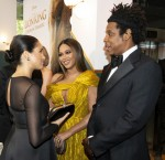 Britain's Meghan, Duchess of Sussex (L) meets cast and crew, including US singer-songwriter Beyoncé (C) and her husband, US rapper Jay-Z (R) as she attends the European premiere of the film The Lion King in London on July 14, 2019.