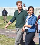 Prince Harry, Duke of Sussex and Meghan, Duchess of Sussex with surf mentors