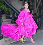 Sarah Jessica Parker heads out in an enormous fuchsia dress and mismatched shoes