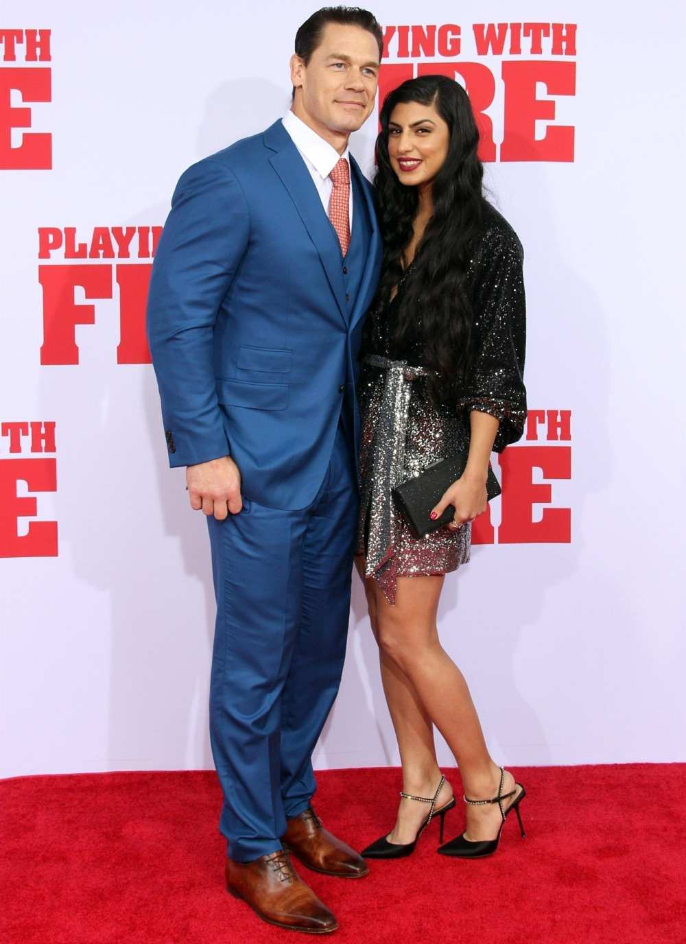 Guests pose at the Playing With Fire US Premiere