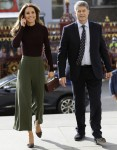 Britain's Kate, The Duchess of Cambridge arrives with Sir Michael Dixon, museum Director at The Natural History Museum in London, Wednesday, Oct. 9, 2019. The Duchess of Cambridge, Patron of the Museum, visited the Natural History Museum's Angela Marmont C