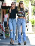 Miley Cyrus and Kaitlynn Carter enjoy an afternoon walk together
