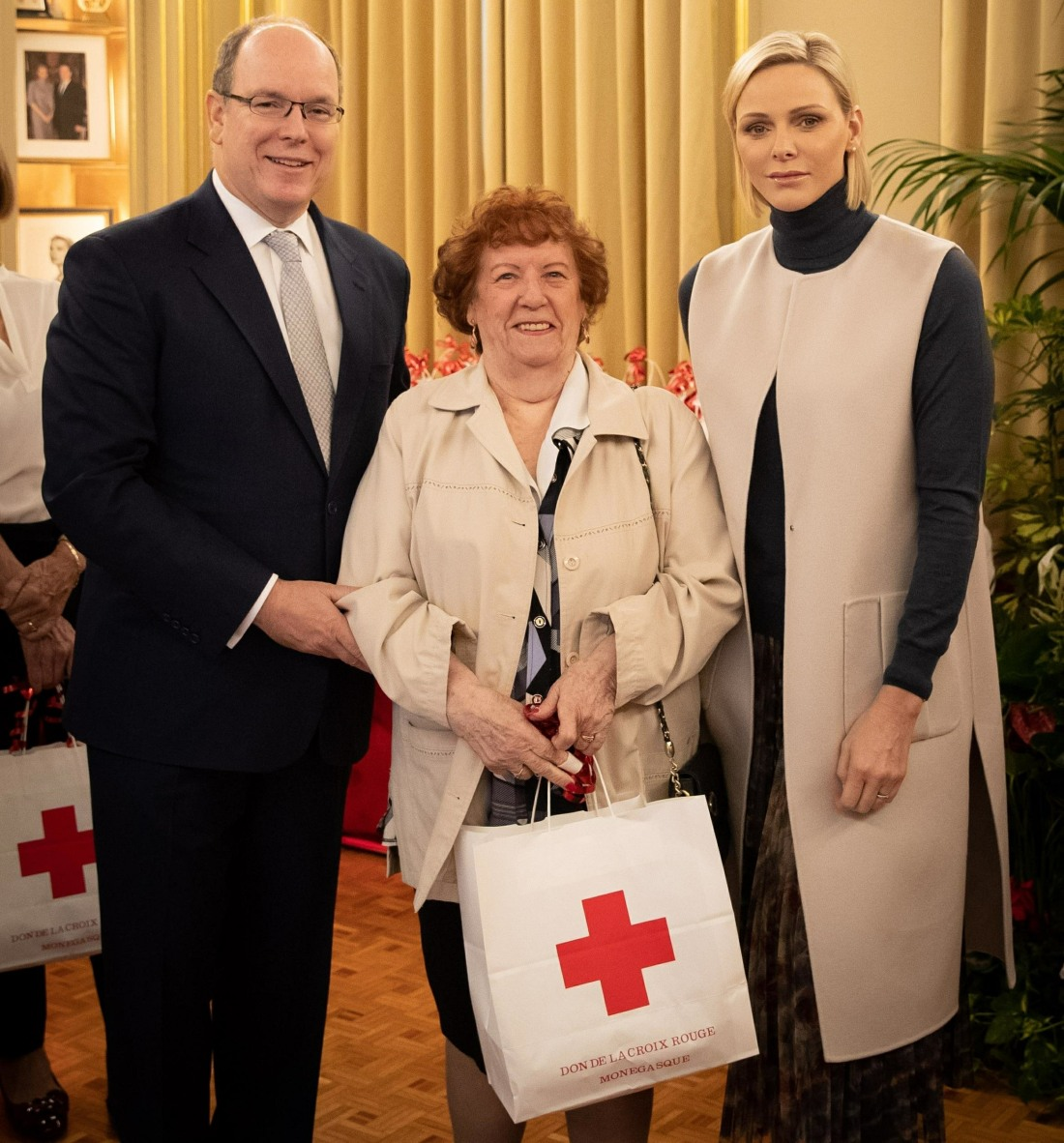 Prince Albert II and Princess Charlene of Monaco present gifts to the disadvantaged at the Monegasque Red Cross office