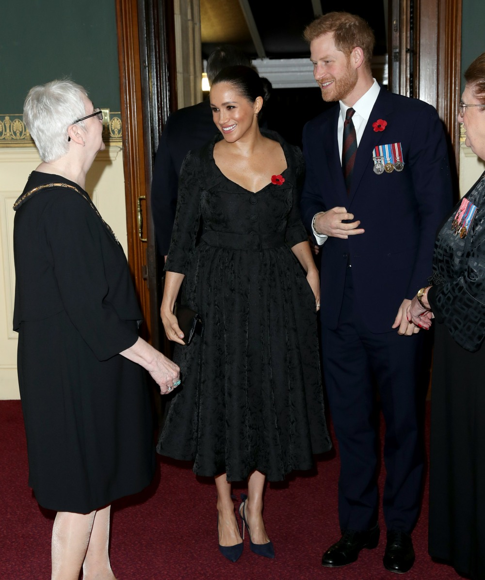 Meghan, Duchess of Sussex (C) and Prince Harry, Duke of Sussex attend the annual Royal British Legion Festival of Remembrance at the Royal Albert Hall on November 09, 2019 in London, England.