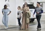 Angelina Jolie shops with her two daughters Vivian and Sahara at the Century City Mall