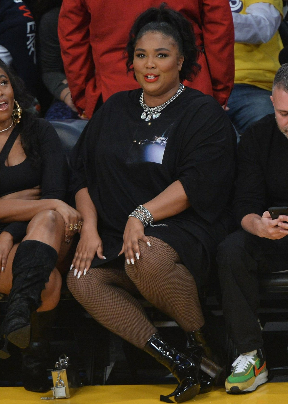 Lizzo clapped back at the people hating on her 'thong dress' at the Lakers game