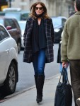 Cindy Crawford leaves her daughter Kaia's apartment in stylish plaid coat