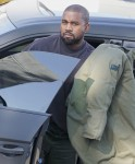 Kanye West makes a quick trip to his office