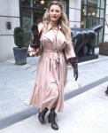 Blake Lively shows off a trench coat style dress while leaving her hotel