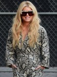 Jessica Simpson shares poses with the cameras as she arrives at Jimmy Kimmel Live