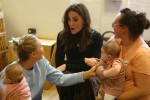 Britain's Catherine, Duchess of Cambridge (C) chats with mothers and babied during her visit to the Ely & Caerau Children's Centre in Cardiff, south Wales on January 22, 2020 as she launches a UK wide survey to help improve early childhood.
