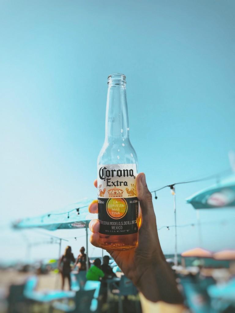 person-holding-corona-extra-bottle-2921584