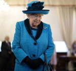 Britain's Queen Elizabeth II looks at stamps of previous British monarchs as she visits the new headquarters of the Royal Philatelic society in London on November 26, 2019.
