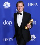 Actor Brad Pitt wearing a Brioni tux poses in the press room at the 77th Annual Golden Globe Awards held at The Beverly Hilton Hotel on January 5, 2020 in Beverly Hills, Los Angeles, California, United States.
