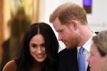 Britain's Prince Harry, Duke of Sussex and Meghan, Duchess of Sussex react during their visit to Canada House in thanks for the warm Canadian hospitality and support they received during their recent stay in Canada,  in London on January 7, 2020.