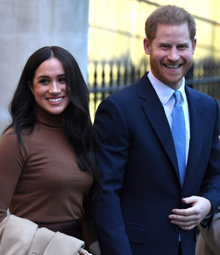 Britain's Prince Harry, Duke of Sussex and Meghan, Duchess of Sussex react as they leave after their visit to Canada House in thanks for the warm Canadian hospitality and support they received during their recent stay in Canada, in London on January 7, 202