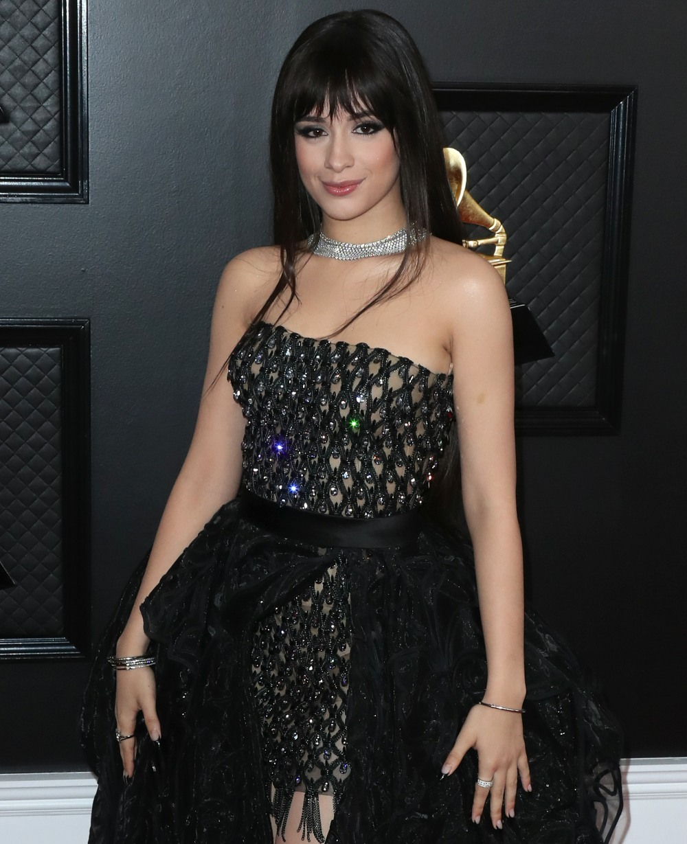 Singer Camila Cabello wearing a Versace dress and shoes with Le Vian jewelry arrives at the 62nd Annual GRAMMY Awards held at Staples Center on January 26, 2020 in Los Angeles, California, United States.
