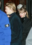 Taylor Swift stays close to her beau as she makes a rare appearance with Joe Alwyn