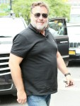 Russell Crowe cuts a casual figure as he returns to his Tribeca hotel with a smile