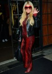 Jessica Simpson wears a leather jacket over a red snakeskin print dress in downtown Manhattan