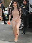 Kim Kardashian puts her curves on display opting for a slit skirt while out in NYC