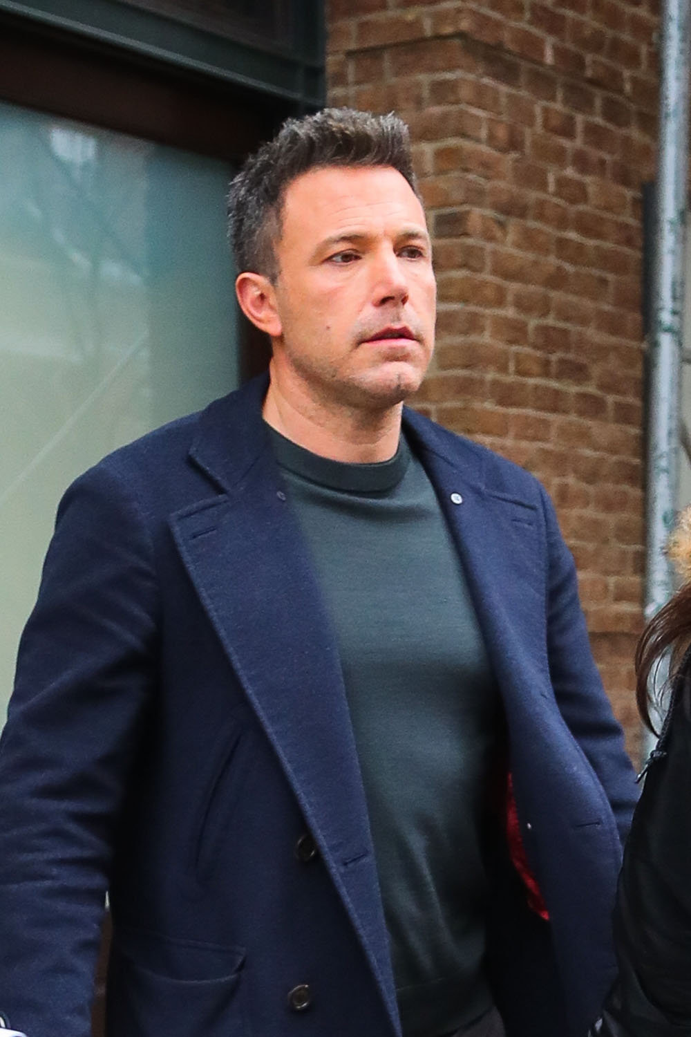 Ben Affleck signs for a few fans leaving The Greenwich Hotel in NYC