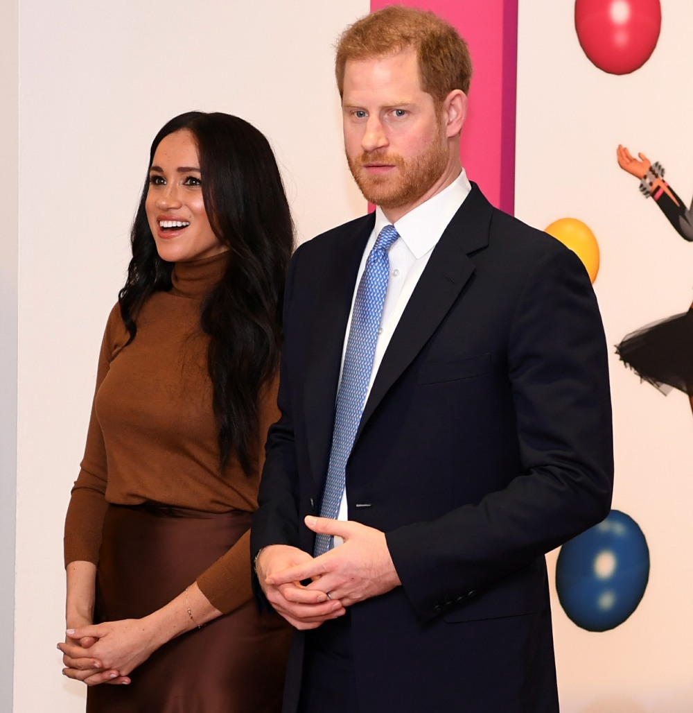Britain's Prince Harry, Duke of Sussex and Meghan, Duchess of Sussex react as they view a special exhibition of art by Indigenous Canadian artist, Skawennati, in the Canada Gallery during their visit to Canada House, in London on January 7, 2020, to give t