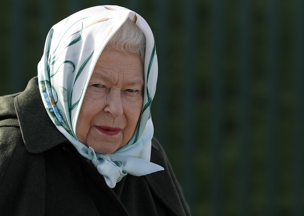 Britain's Queen Elizabeth II reacts during her visit to Wolferton Pumping Station in Norfolk, east of England on February 5, 2020, where she officially opened the new station. - Wolferton Pumping Station allows the surrounding 7,000 acres of marshland, whi
