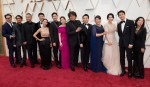 """Oscar® nominee, Bong Joon Ho (C) and the cast of """"Parasite"""" arrive on the red carpet of The 92nd..."""