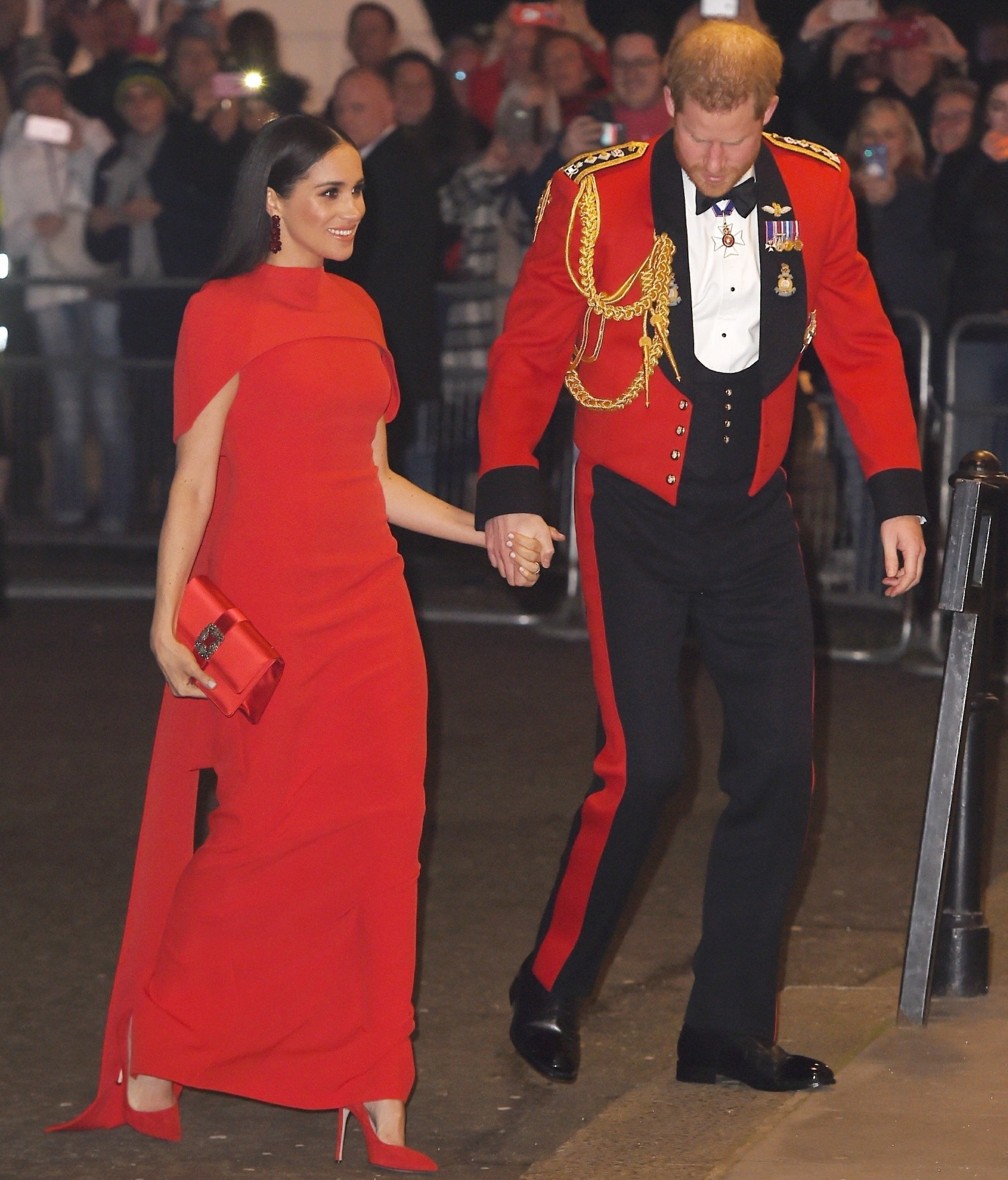 The Duke and Duchess of Sussex are pictured during their arrival at The Mountbatten Festival of Music