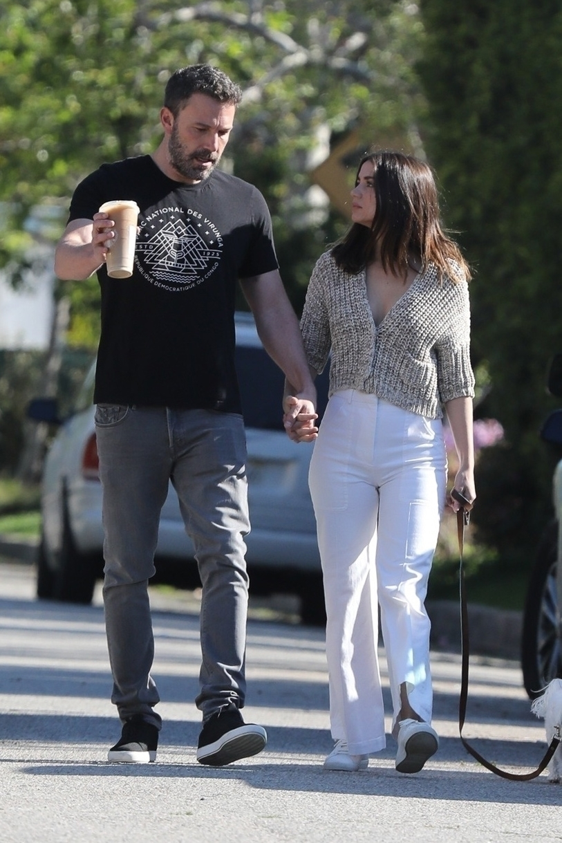 Ben Affleck looks smitten during a PDA filled walk with his new girlfriend Ana de Armas and her adorable dog