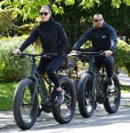 Robin Wright Clement Giraudet ride their bikes with their dog