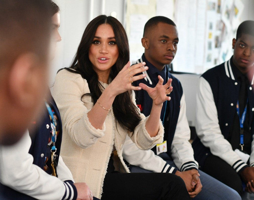 Britain's Meghan, Duchess of Sussex, sits in a discussion of the 'Senior Debate Squad' during a visit to Robert Clack School in Essex, on March 6, 2020, in support of International Women's Day.  / == STRICTLY EMBARGOED == NO USE AND NO PUBICATION ON ANY PLATFORM UNTIL 22:30 GMT MARCH 7, 2020 ==