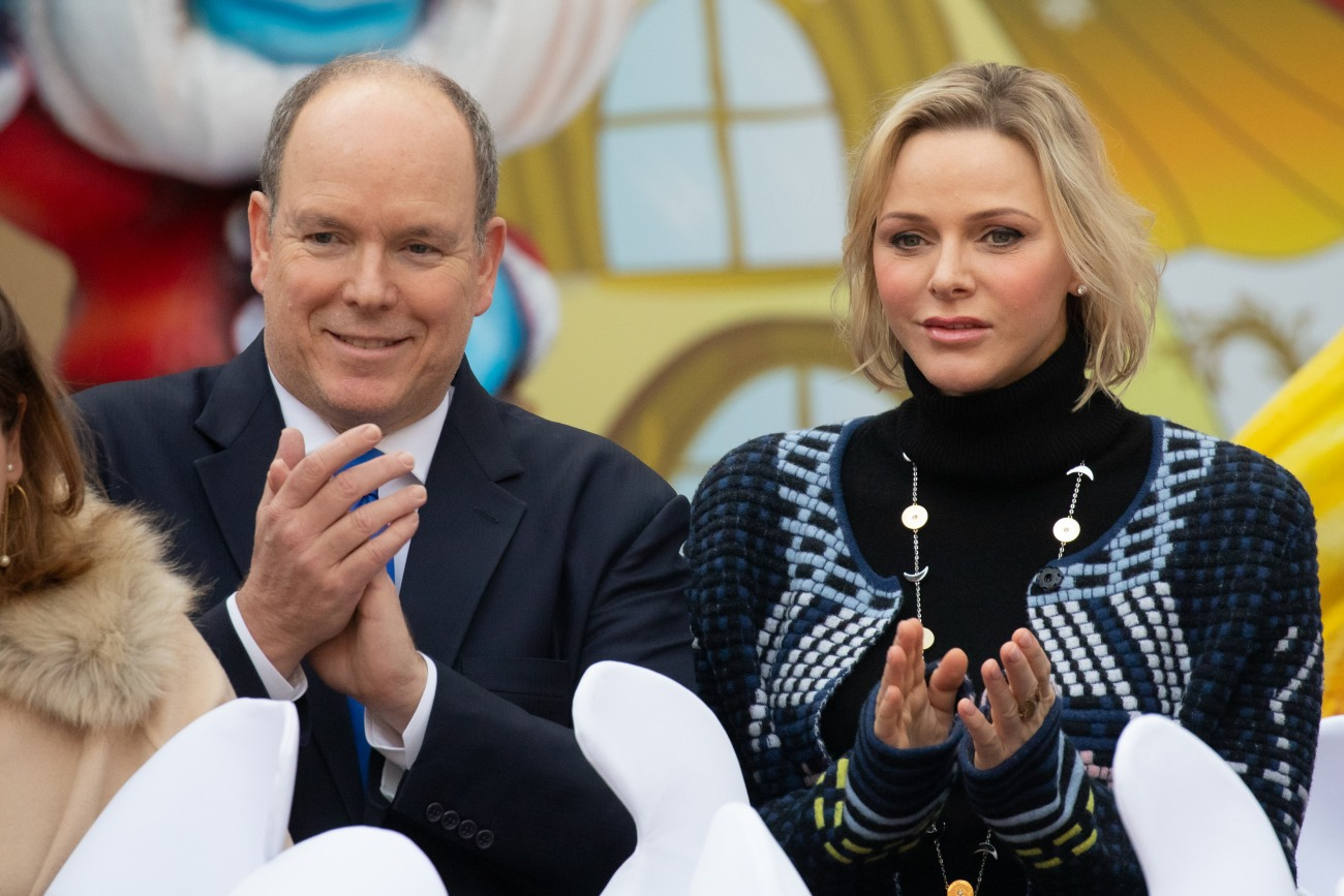 Prince Albert II and Princess Charlene of Monaco attend the Christmas Gifts Distribution At Monaco Palace