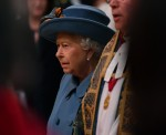 Britain's Queen Elizabeth II (L) and The Very Reverend Dr David Hoyle, Dean of Westminster (R) attend the annual Commonwealth Service at Westminster Abbey in London on March 09, 2020. - Britain's Queen Elizabeth II has been the Head of the Commonwealth thr