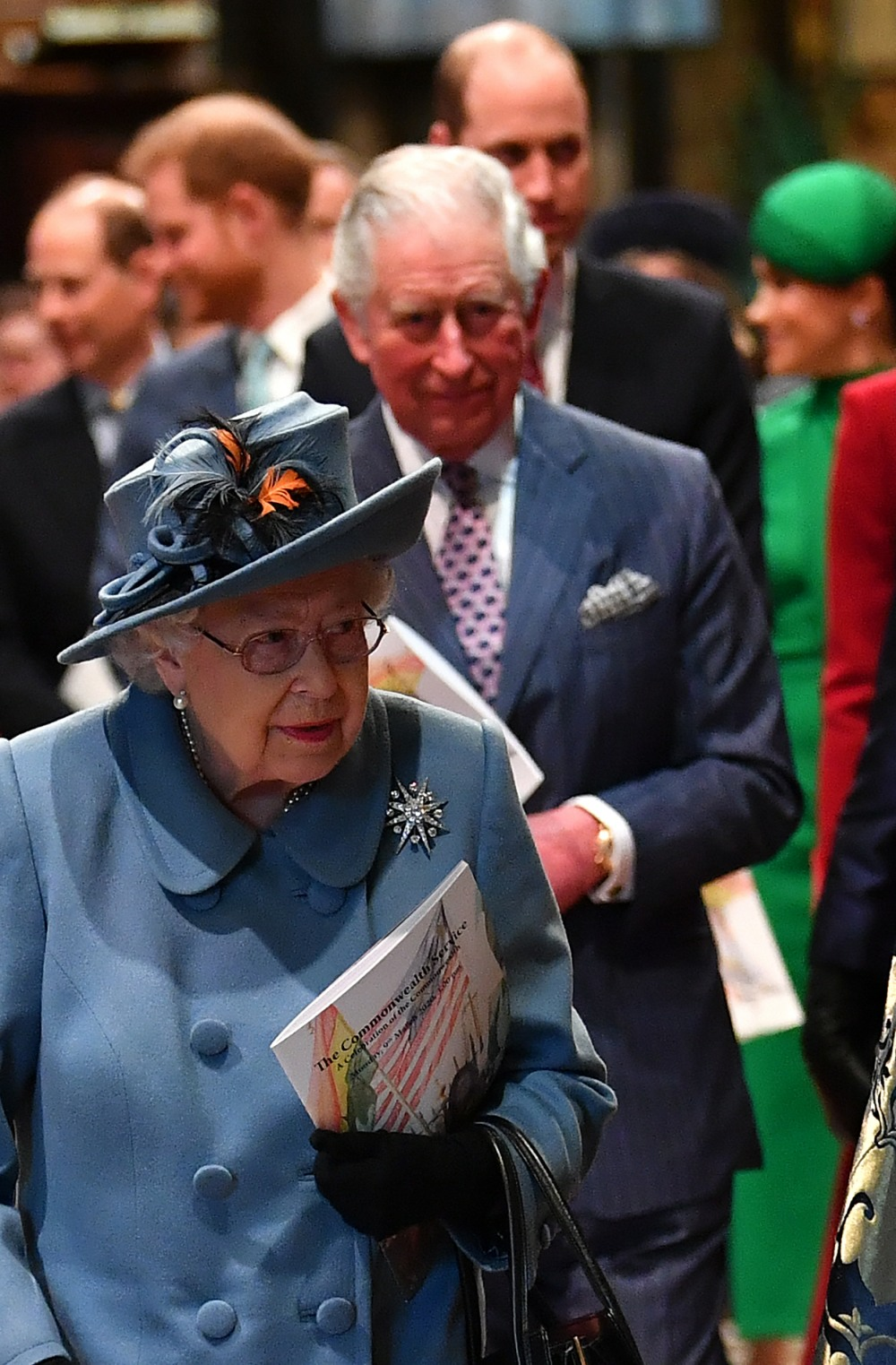 Britain's Queen Elizabeth II (C), followed by Britain's Prince Edward, Earl of Wessex (L), Britain's Prince Harry, Duke of Sussex (2L), Britain's Prince Charles, Prince of Wales (centre R), Britain's Prince William, Duke of Cambridge, (2R) and Meghan, Duch