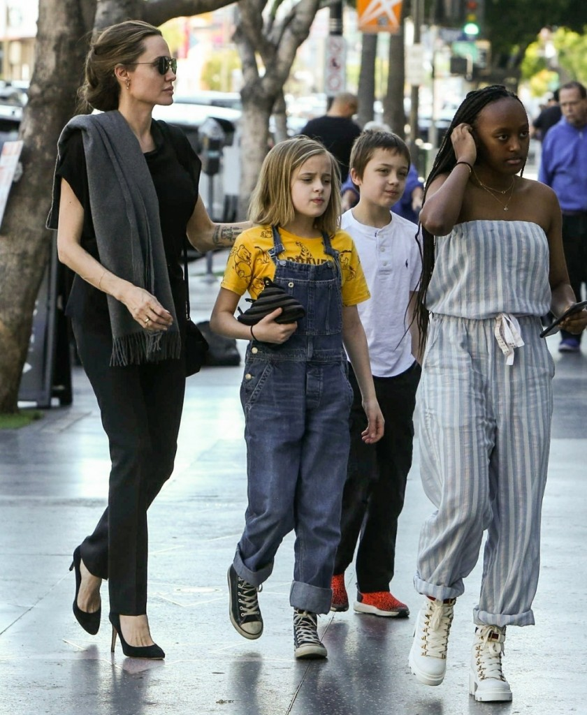 Angelina Jolie brings the kids on a sushi date in Los Angeles and the kids seem really excited!