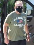 Arnold Schwarzenegger dons customized tee during his daily bike ride!