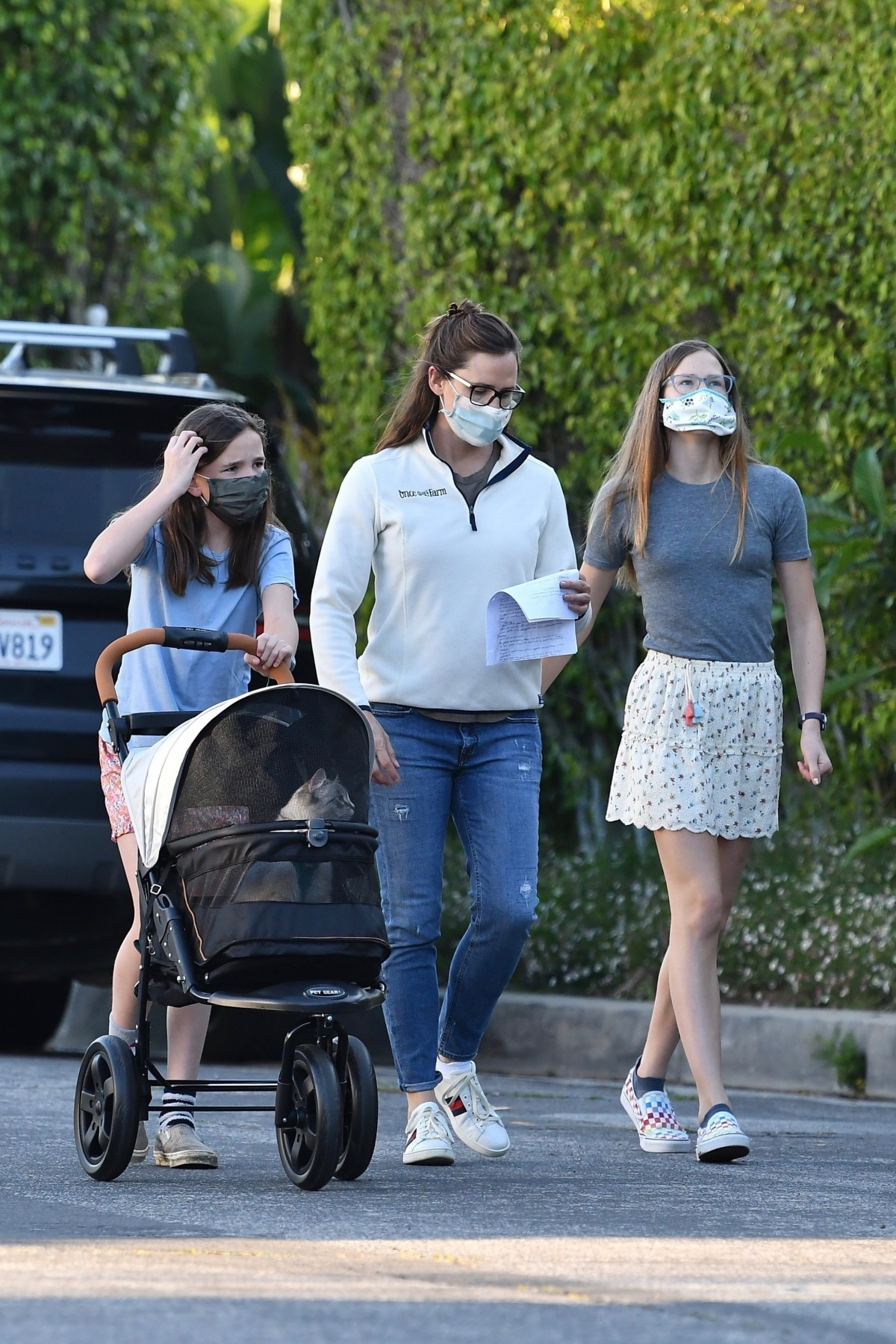 Jennifer Garner goes for a walk with her girls and the family cat