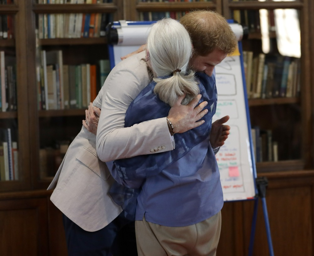 Britain's Prince Harry, the Duke of Sussex and Dr Jane Goodall hug as he attends Dr Jane Goodall's Roots & Shoots Global Leadership Meeting at St. George's House, Windsor Castle in England, Tuesday, July 23, 2019. Roots & Shoots is a global programme empowering young people of all ages, working to ignite and inspire the belief that every individual can take action to make the world a better place for people, animals and the environment.