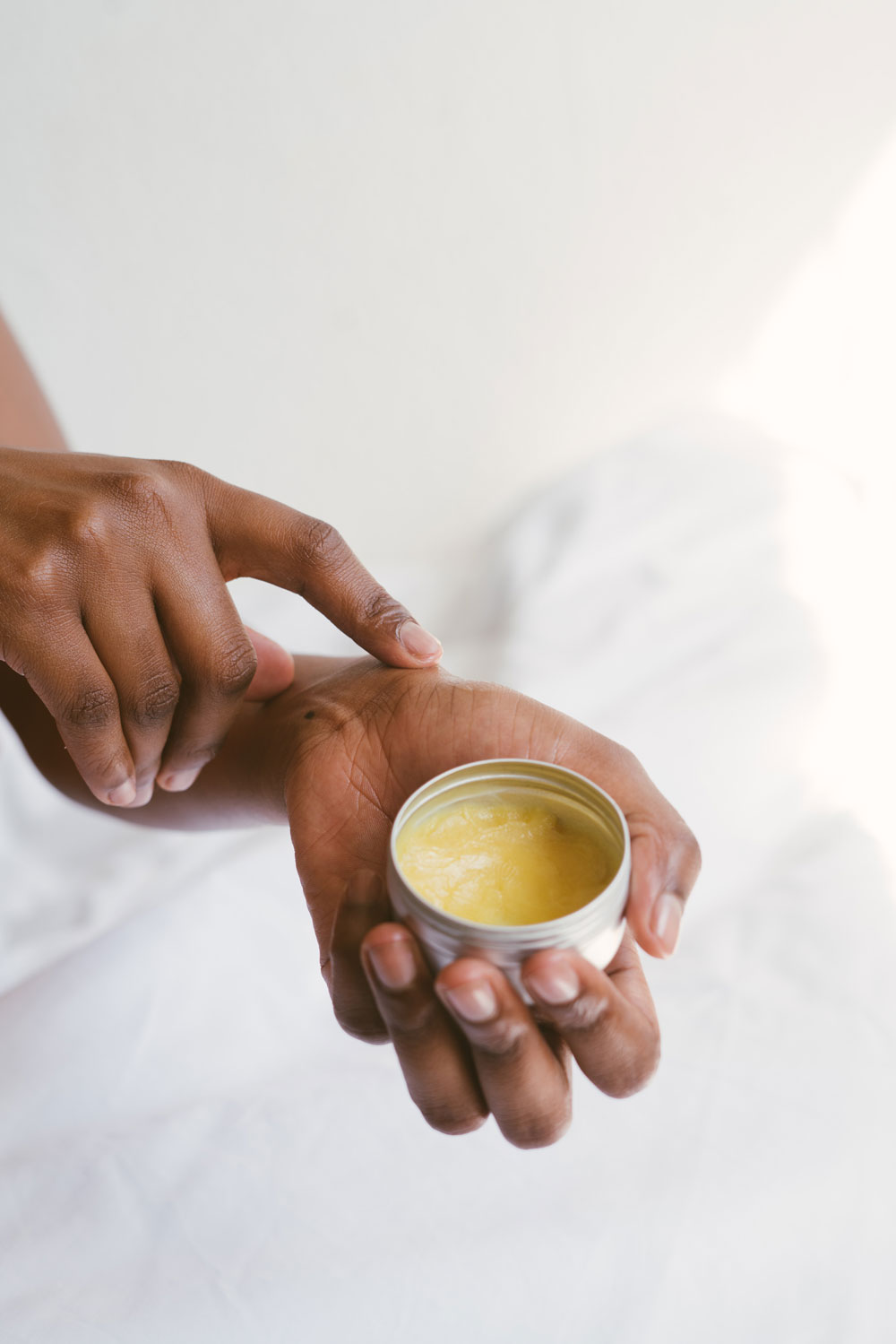 person-holding-a-hand-cream-3059398